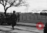 Image of Elements of the U.S. 1st Cavalry Division advancing  Manila Philippines, 1945, second 59 stock footage video 65675071952
