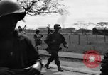 Image of Elements of the U.S. 1st Cavalry Division advancing  Manila Philippines, 1945, second 60 stock footage video 65675071952