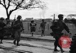 Image of Elements of the U.S. 1st Cavalry Division advancing  Manila Philippines, 1945, second 61 stock footage video 65675071952