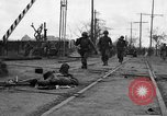 Image of General Mudge and troops of U.S. 1st Cavalry Division Manila Philippines, 1945, second 13 stock footage video 65675071953