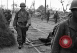 Image of General Mudge and troops of U.S. 1st Cavalry Division Manila Philippines, 1945, second 21 stock footage video 65675071953