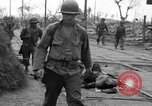 Image of General Mudge and troops of U.S. 1st Cavalry Division Manila Philippines, 1945, second 23 stock footage video 65675071953