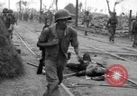 Image of General Mudge and troops of U.S. 1st Cavalry Division Manila Philippines, 1945, second 26 stock footage video 65675071953