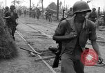 Image of General Mudge and troops of U.S. 1st Cavalry Division Manila Philippines, 1945, second 27 stock footage video 65675071953