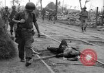 Image of General Mudge and troops of U.S. 1st Cavalry Division Manila Philippines, 1945, second 30 stock footage video 65675071953
