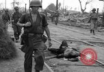 Image of General Mudge and troops of U.S. 1st Cavalry Division Manila Philippines, 1945, second 31 stock footage video 65675071953