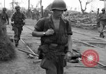 Image of General Mudge and troops of U.S. 1st Cavalry Division Manila Philippines, 1945, second 32 stock footage video 65675071953