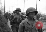 Image of General Mudge and troops of U.S. 1st Cavalry Division Manila Philippines, 1945, second 34 stock footage video 65675071953