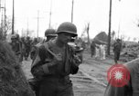 Image of General Mudge and troops of U.S. 1st Cavalry Division Manila Philippines, 1945, second 35 stock footage video 65675071953