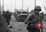 Image of General Mudge and troops of U.S. 1st Cavalry Division Manila Philippines, 1945, second 38 stock footage video 65675071953