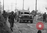 Image of General Mudge and troops of U.S. 1st Cavalry Division Manila Philippines, 1945, second 39 stock footage video 65675071953