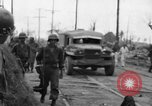 Image of General Mudge and troops of U.S. 1st Cavalry Division Manila Philippines, 1945, second 40 stock footage video 65675071953