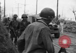 Image of General Mudge and troops of U.S. 1st Cavalry Division Manila Philippines, 1945, second 41 stock footage video 65675071953