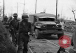 Image of General Mudge and troops of U.S. 1st Cavalry Division Manila Philippines, 1945, second 42 stock footage video 65675071953