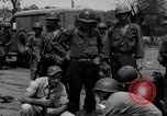 Image of General Mudge and troops of U.S. 1st Cavalry Division Manila Philippines, 1945, second 49 stock footage video 65675071953