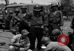 Image of General Mudge and troops of U.S. 1st Cavalry Division Manila Philippines, 1945, second 50 stock footage video 65675071953
