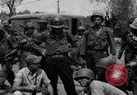 Image of General Mudge and troops of U.S. 1st Cavalry Division Manila Philippines, 1945, second 58 stock footage video 65675071953