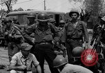 Image of General Mudge and troops of U.S. 1st Cavalry Division Manila Philippines, 1945, second 59 stock footage video 65675071953