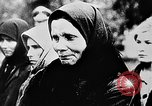 Image of mass burial Ukraine, 1944, second 18 stock footage video 65675071994
