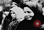 Image of mass burial Ukraine, 1944, second 19 stock footage video 65675071994