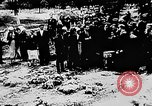 Image of mass burial Ukraine, 1944, second 20 stock footage video 65675071994