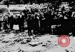 Image of mass burial Ukraine, 1944, second 21 stock footage video 65675071994