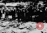 Image of mass burial Ukraine, 1944, second 22 stock footage video 65675071994