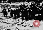 Image of mass burial Ukraine, 1944, second 23 stock footage video 65675071994