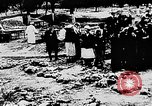 Image of mass burial Ukraine, 1944, second 24 stock footage video 65675071994