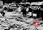 Image of mass burial Ukraine, 1944, second 25 stock footage video 65675071994