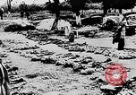 Image of mass burial Ukraine, 1944, second 28 stock footage video 65675071994