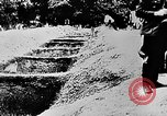 Image of mass burial Ukraine, 1944, second 34 stock footage video 65675071994