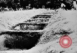 Image of mass burial Ukraine, 1944, second 35 stock footage video 65675071994