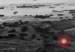 Image of Normandy beachhead filled with reinforcement troops and equipment France, 1944, second 6 stock footage video 65675072013
