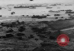 Image of Normandy beachhead filled with reinforcement troops and equipment France, 1944, second 7 stock footage video 65675072013