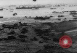 Image of Normandy beachhead filled with reinforcement troops and equipment France, 1944, second 8 stock footage video 65675072013