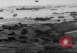 Image of Normandy beachhead filled with reinforcement troops and equipment France, 1944, second 9 stock footage video 65675072013