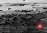 Image of Normandy beachhead filled with reinforcement troops and equipment France, 1944, second 10 stock footage video 65675072013