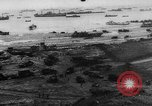 Image of Normandy beachhead filled with reinforcement troops and equipment France, 1944, second 11 stock footage video 65675072013