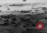 Image of Normandy beachhead filled with reinforcement troops and equipment France, 1944, second 13 stock footage video 65675072013
