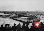 Image of Normandy beachhead filled with reinforcement troops and equipment France, 1944, second 14 stock footage video 65675072013