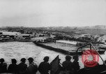 Image of Normandy beachhead filled with reinforcement troops and equipment France, 1944, second 15 stock footage video 65675072013