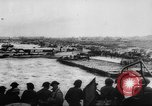Image of Normandy beachhead filled with reinforcement troops and equipment France, 1944, second 16 stock footage video 65675072013