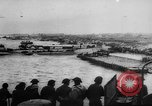 Image of Normandy beachhead filled with reinforcement troops and equipment France, 1944, second 18 stock footage video 65675072013