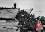 Image of Normandy beachhead filled with reinforcement troops and equipment France, 1944, second 19 stock footage video 65675072013