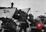 Image of Normandy beachhead filled with reinforcement troops and equipment France, 1944, second 20 stock footage video 65675072013