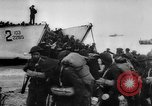 Image of Normandy beachhead filled with reinforcement troops and equipment France, 1944, second 21 stock footage video 65675072013