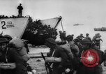 Image of Normandy beachhead filled with reinforcement troops and equipment France, 1944, second 22 stock footage video 65675072013