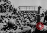 Image of Normandy beachhead filled with reinforcement troops and equipment France, 1944, second 27 stock footage video 65675072013