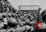 Image of Normandy beachhead filled with reinforcement troops and equipment France, 1944, second 28 stock footage video 65675072013